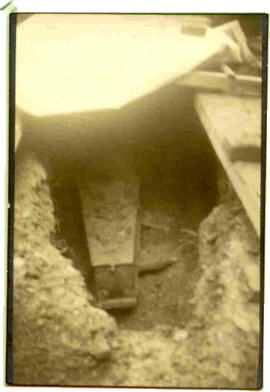 1937 Exhumation: nearer view of coffin after grave opening